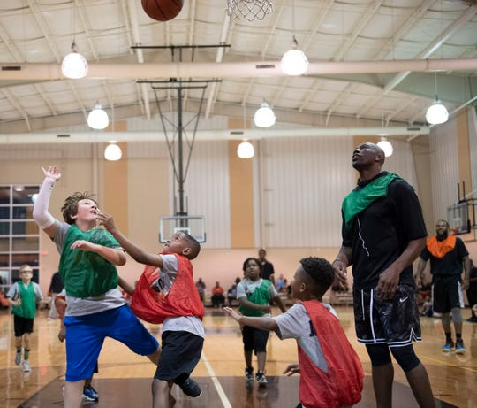 Terrell Owens plays basketball with kids attending Trevor Booker's basketball camp at Mauldin Sports Center Friday, June 14, 2019.