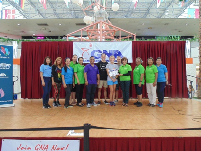 The Guam Nurses Association presented the Guam Diabetes Association a certificate of appreciation during its Health Fair on May 19 at the Micronesian Mall. Pictured from left: Volunteers from GDA, GNA and US Naval Hospital Guam. Elizabeth Santos, Yvonne Harris, Glynis Almonte, Joame Topacio, Eva Allen, Patrick Luces, Zachary Knueven, Michaela Haffarman, Drew Turnbough, Winnie Butler, Rosa Giramur, Lisa Kenworthy and Rose Grino.