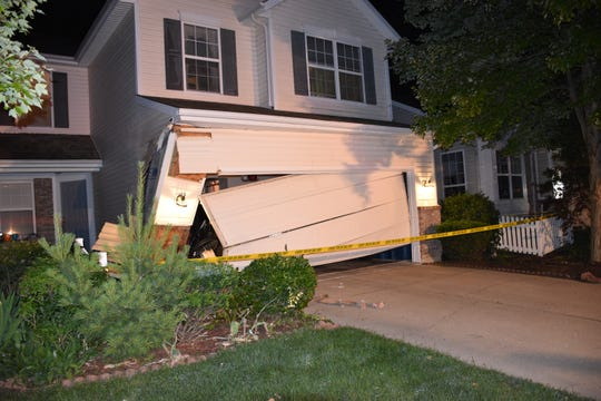 "Police say a home in the heart of Carmel sustained ""heavy damage"" after an intoxicated man drove into it early Friday."