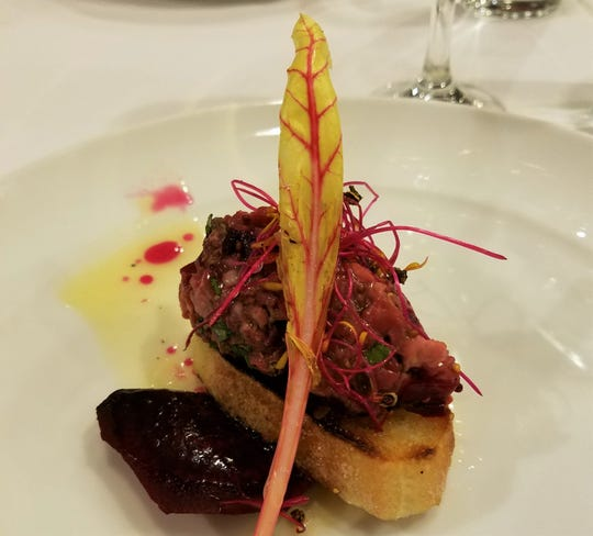 Delicate tartare of beef, beets and capers spooned on French bread and artfully arranged at a private dinner prepared by chef Charles Mereday, who on June 15, 2019, opened Qualita Italian restaurant, 1351 W. 86th St.