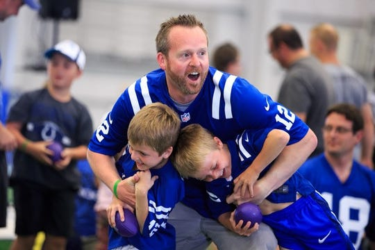 A father and sons enjoy the All-Pro Dads event.