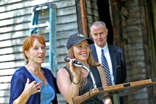 Demolition is underway at 1230 S. Talbott St., Friday, June 14, 2019. The home was used as a backdrop for mayoral candidate Jim Merritt the day before, to launch his housing plan while chastising his Democratic opponent Mayor Joe Hogsett's blighted housing plan.  Karen E Laine, left, and Mina Starsiak Hawk, center, mother and daughter team of Two Chicks and a Hammer own the property.  Friday, Mayor Joe Hogsett and the renovating homeowners held a press conference to talk about the home's timeline.