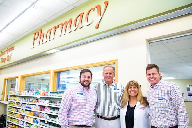 Hartig Drug CEO, Charlie Hartig, from left, Dick Hartig, Anne Lohaus, and Wes Hartig, pose for a photo, Friday, June 14, 2019, at Hartig Drug located on Mormon Trek Blvd. in Iowa City, Iowa.