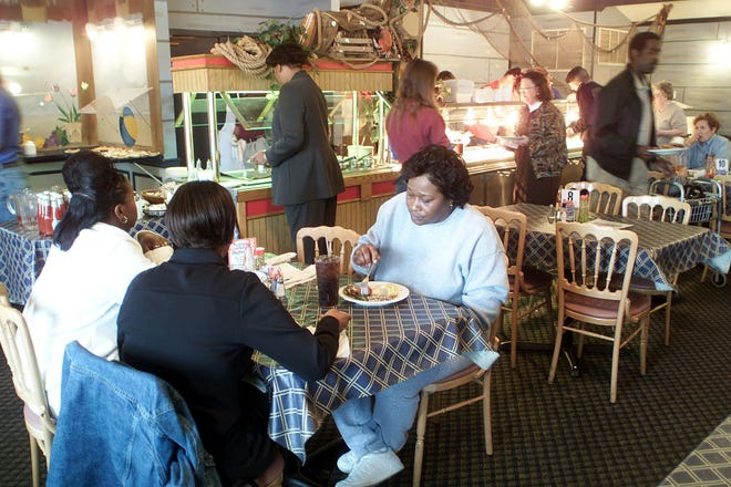 This 2001 photo shows customers enjoying the lunch buffet at Penn's Fish House on Lakeland Drive.