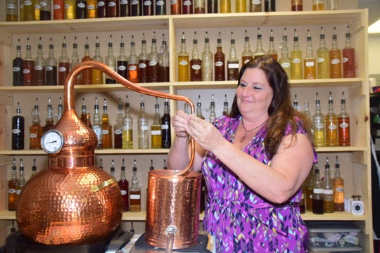 Tammy Galyon works with a still she uses to make essential oils at Nature's Crossing Health and Beauty 8901 Oak Ridge Highway.
