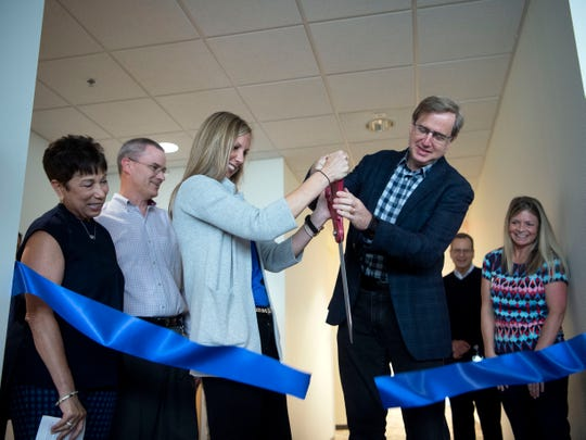 From left, Discovery executives Adria Alpert Romm, Pete Crowley, Laurie Delahunty, Ralph Beidelman, Larry Laque and Whitney North gather for the ribbon cutting into the wellness and fitness center to Discovery's Knoxville headquarters on Thursday, June 13, 2019.