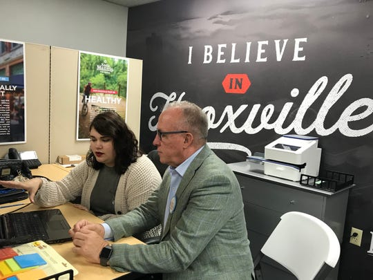 Intern Caitlin Goff goes over with Knoxville mayoral candidate Eddie Mannis the topics that have come up from potential voters when campaign workers have called them.