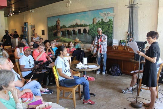 An audience listens during one of Festival of Words Cultural Arts Collective's literary gatherings. Alexander Books and Festival of Words is hosting its first Sharing Circle on June 18th. The subject is Mama's Kitchen and everyone is welcome to tell their favorite food stories.