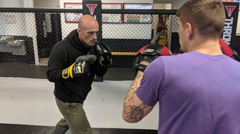 Eric Scallan, mixed martial artist and owner of Gladiators Academy in Youngsville, prepares for his upcoming fight against Lance Thomson this Saturday