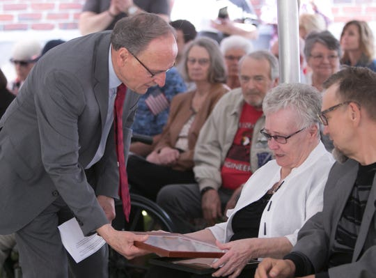 State Rep. Hank Vaupel presents a proclamation to Twyla Burgett, wife of the late Donald Burgett at a dedication ceremony for the Howell Post office in honor of Donald Burgett Friday, June 14, 2019.