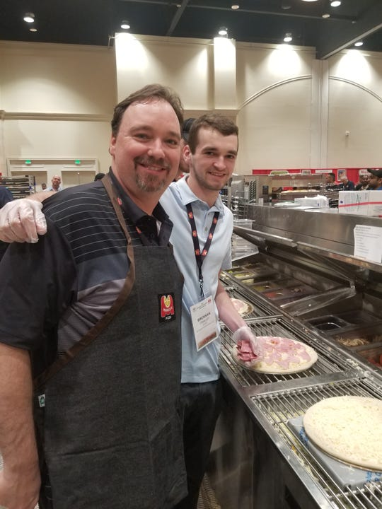 Dan O'Malley, who co-owns Marco's Pizza franchise locations in Livingston County and elsewhere, made one of the top pizza's in the company's annual Pizza Creation Contest in May, with help from his son Brennan.