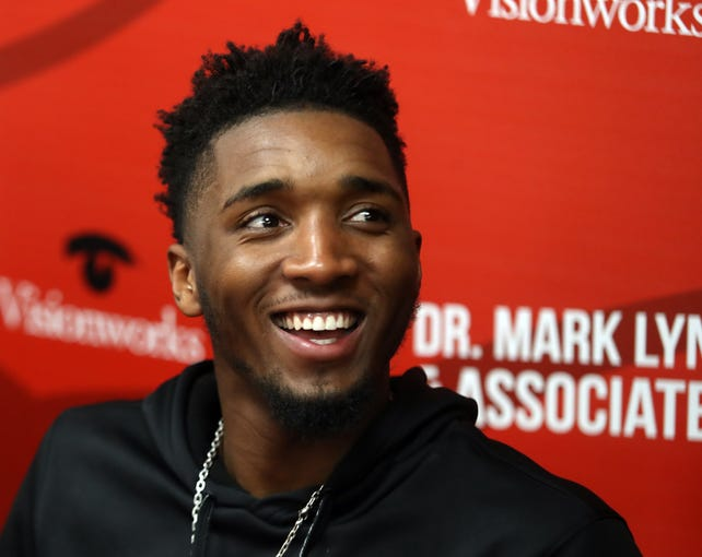 Utah Jazz player Donovan Mitchell, former Louisville Cardinal, signs autographs for fans at Vision Works in Downtown Louisville on June 14, 2019.