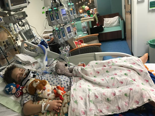Brenden Scott, 10, of Mason spent a month in Sparrow Hospital after a mini-van hit him while he was crossing the road in December. After his heart stopped in an operating room, doctors spent 20 minutes compressing it by hand.