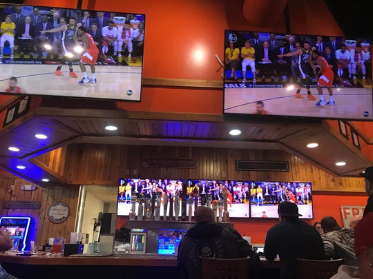 Fans watch Game 6 of the NBA Finals from a Hooters restaurant in Saginaw, Michigan. No matter who they wanted to win the game, most fans rooted for the hometown kid, Draymond Green.