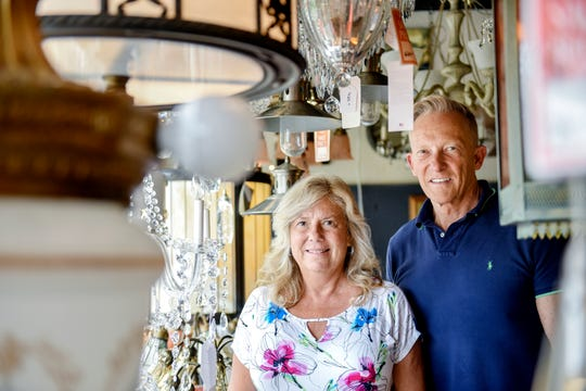 Steve Bohnet, president of the Bohnet Electric Co., right, and his niece Sheri Melville, manager, photographed in the store's showroom on Wednesday, June 12, 2019, in Lansing. The business is closing its lighting showroom after 113 years.