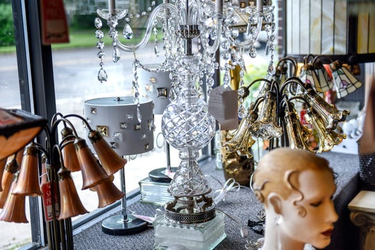 A selection of lighting options on display at Bohnet Electric Co. on Wednesday, June 12, 2019, in Lansing. The business is closing its lighting showroom after 113 years.