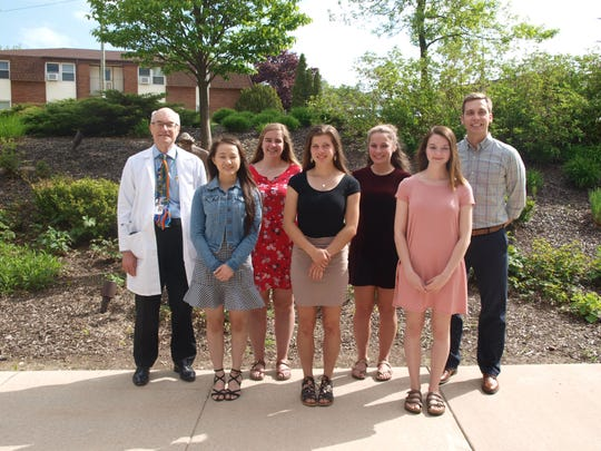 Holy Family Memorial announces the 2019 recipients of the HFM Medical/Dental Scholarship. Pictured, from left, front row:Sunny Lee, Jenna Zahorik and Kalysta Zdanowski; and back row,Dr. Larry Verlinden, Katherine Satori, Taylor Walesh and Jered Muench.