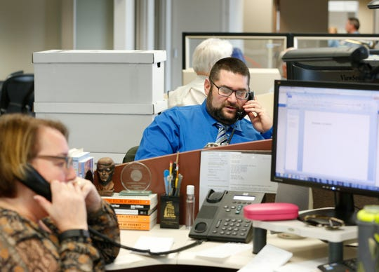 Jim Siegel is shown working at his desk at the Columbus Dispatch.