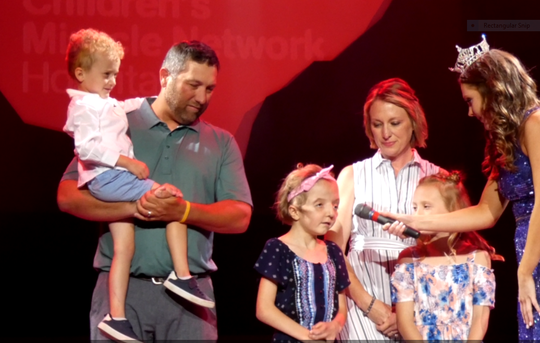 Miss Ohio Matti-Lynn Chrisman talked with the Boz and Ashley Daughery family of Zanesville whose daughter Raegan, center, has benefited from the services of Childrens Miracle Network hospitals. Her brother Tyler and sister Drew also were on stage.
