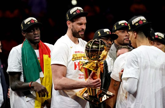 Jun 13, 2019; Oakland, CA, USA; Toronto Raptors center Marc Gasol (33) celebrates with the Larry O'Brien Trophy after beating the Golden State Warriors in game six of the 2019 NBA Finals at Oracle Arena.