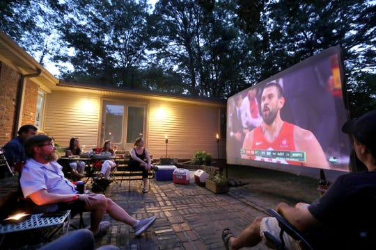Jason Peters, left, the high school coach of Marc Gasol at Lausanne, watches with friends at the home as Gasol wins an NBA Championship with the Toronto Raptors  on Thursday, June 13, 2019.