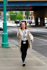Milwaukee Journal Sentinel reporter Sarah Hauer records her walk to the Milwaukee Public Market as five reporters race on five modes of transit in downtown Milwaukee on Wednesday, June 12, 2019. Hauer placed third in the race.