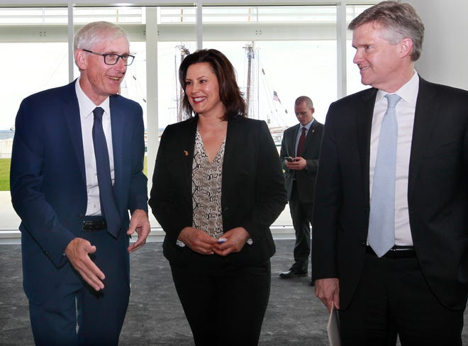 Wisconsin Gov. Tony Evers, from left,  Michigan Gov. Gretchen Whitmer and Minister of the Environment, Conservation and Parks, Rod Phillips of Ontario, leave a news conference after sharing highlights of their 2019 Leadership Summit at Discovery World. Evers, along with other governors and premiers, were in Milwaukee to discuss a series of actions on water, transportation, impact investing and tourism as related to the Great Lakes and St. Lawrence River.