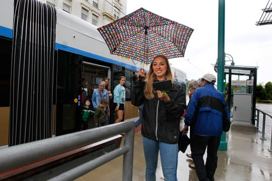 Milwaukee Journal Sentinel reporter, Jordyn Noennig, arrives at the Milwaukee Public Market after catching The Hop for the Journal Sentinel's race on five modes of transit on Wednesday, June 12, 2019. Noennig, although the last to arrive, was all smiles as she makes her way to the end of the race.