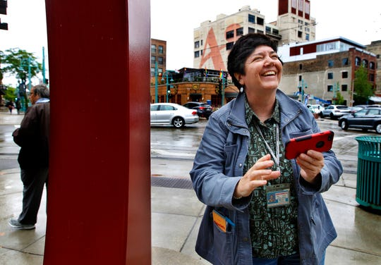 Milwaukee Journal Sentinel reporter Meg Jones is all smiles as she arrives first at the Milwaukee Public Market in the Journal Sentinel race on Wednesday, June 12, 2019. The goal was for five reporters, five modes of transportation and one mission: go from Burns Commons to the Milwaukee Public Market in downtown. Get there on foot, with an Uber, a bike, The Hop, or a city bus. Which way is fastest? For Jones the winner, it was by Uber.