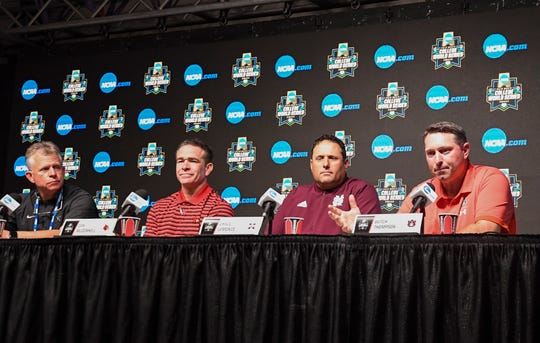 Vanderbilt's Tim Corbin, Louisville's Dan McDonnell, Mississippi State's Chris Lemonis and Auburn's Butch Thompson during a coaches press conference at the College World Series on Friday, June 14, 2019, in Omaha, NE.