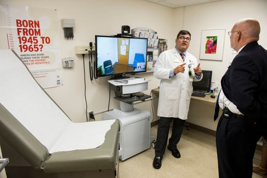 Dr. Carlos Reyes-Sacin shows CDC director Robert Redfield his clinic and its telemedicine capabilities at the Medical Advocacy and Outreach clinic in Montgomery, Ala. on Friday, June 14, 2019.