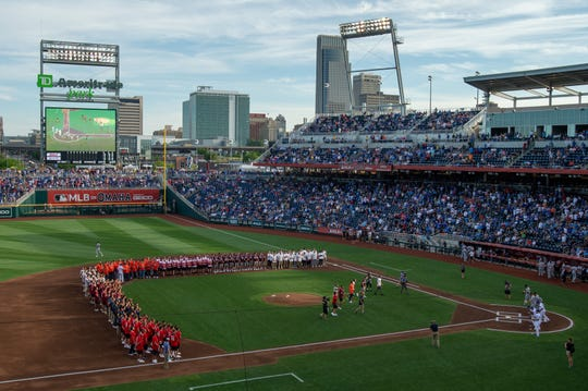 The eight teams participating in the College World Series participate in a ceremonial first pitch before the game between the Kansas City Royals and the Detroit Tigers at TD Ameritrade Park on June 13, 2019, in Omaha, NE.