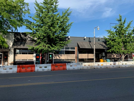 After a neighboring building collapse forced them to close, Hillsboro Village's Fido put up signs condemning chains, announcing plans to reopen.