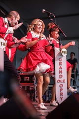 The Grand Ole Opry Dancers take a spin during the Grand Ole Opry at Bonnaroo on June 13, 2019 in Manchester, Tenn.