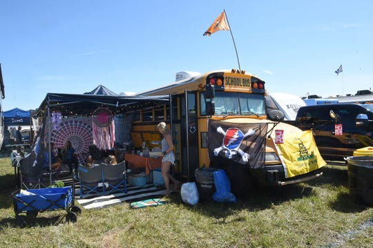 A renovated school bus is a home for Martha Walters and her family on Friday, June 14, during the Bonnaroo Music and Arts Festival in Manchester, Tenn.