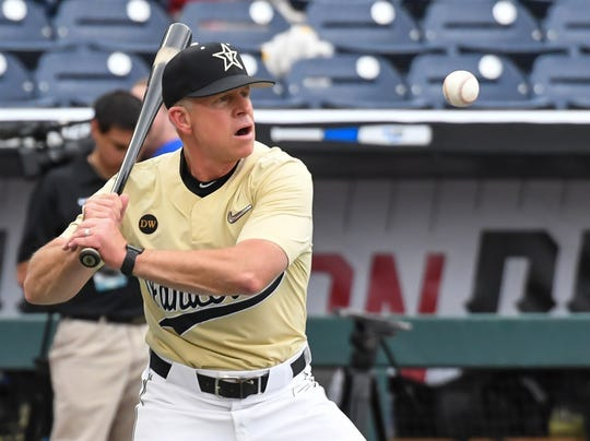 Vanderbilt Commodores coach Tim Corbin (4) hits infield balls during team practice day before the start of the College World Series at TD Ameritrade Park Omaha on June 14, 2019