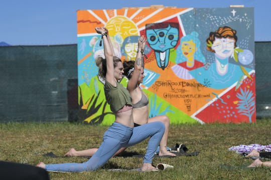 Festival goers participate in the Yoga class in SheRoo campground on Friday, June 14, during the Bonnaroo Music and Arts Festival in Manchester, Tenn.