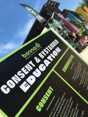 A sign set up at Plaza 2 of the campgrounds offers information about consent and touch. The Sanctuary Of Self Love plaza is curated by Hayley Williams of Paramore.