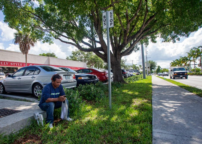 East Naples resident Juan Arreguin waits for a Collier Area Transit bus, Friday, June 14, 2019, at a bus stop on Radio Road in East Naples.