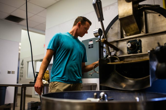 Andrew Natali roasts coffee beans at the Florida Culinary Accelerator @ Immokalee on Thursday, June 13, 2019. Natali is the chief business developer for Guadalupe Roastery, one of many small businesses that use the facility to process their products.