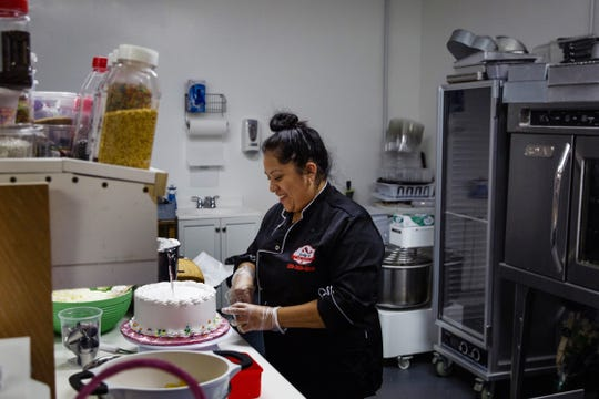 Judy Starkweather prepares a birthday cake at her business, Judy's Pastry and Bakery, in Naples on Thursday, June 13, 2019. Starkweather started her business at home five years ago and spent one month at the Florida Culinary Accelerator @ Immokalee. Her business has been at the Naples location for seven months.