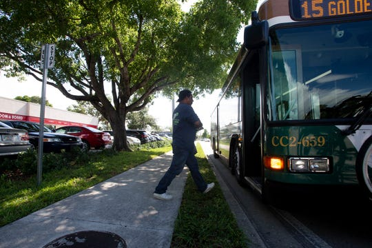 Juan Arreguin of East Naples boards a Collier Area Transit bus, Friday, June 14, 2019, at a bus stop on Radio Road in East Naples.