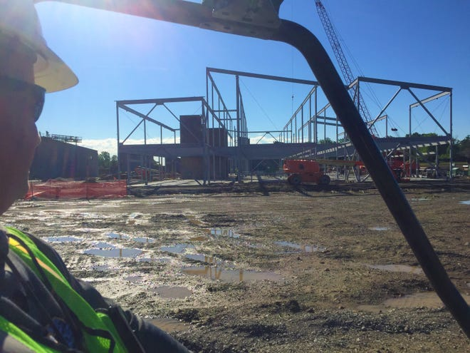 Ryan Felumlee, superintendent for Robertson Construction, looks out at the structural steel work in place on June 14 for educational areas at the new Licking Heights High School.