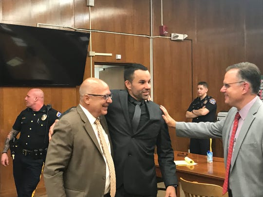 Marc Messing and his attorneys John Bruno and Kenneth Ralph after the verdict in June 2019.