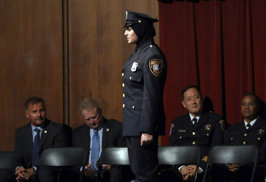 Serein Tamimi waits to receive her certificate during Bergen County Police Academy graduation at Bergen County Academies in Hackensack June 13, 2019. Tamimi was sworn in as the first Palestinian American woman and hijab-wearing police officer in Paterson this week.