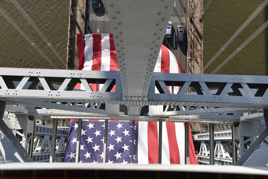 The world's largest free flying flag hangs from the New Jersey Tower of the George Washington Bridge on Flag Day Friday June 14, 2019 in Fort Lee, N.J.