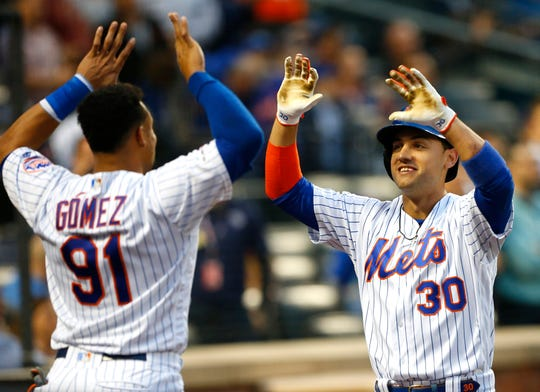 June 13, 2019; New York City, NY, USA; New York Mets right fielder Michael Conforto (30)  celebrates with New York Mets right field home run in the third inning against the St. Louis Cardinals at Citi Field. Mandatory Credit: Noah K. Murray-USA TODAY Sports
