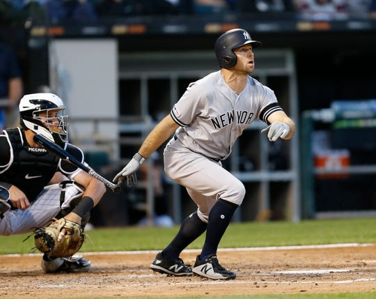 New York Yankees' Brett Gardner watches his two-run home run against the Chicago White Sox during the fourth inning of a baseball game Thursday, June 13, 2019, in Chicago. (AP Photo/Nuccio DiNuzzo)