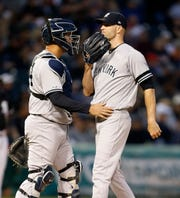 New York Yankees' catcher Gary Sanchez talks to starting pitcher J.A. Happ during the fourth inning of the team's baseball game against the Chicago White Sox on Thursday, June 13, 2019, in Chicago. (AP Photo/Nuccio DiNuzzo)
