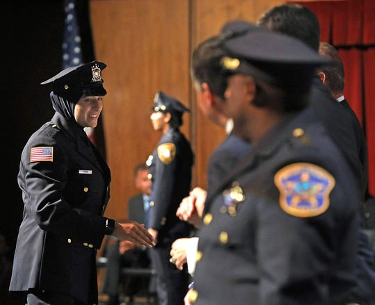 Serein Tamimi accepts her certificate during Bergen County Police Academy graduation at Bergen County Academies in Hackensack June 13, 2019. Tamimi was sworn in as the first Palestinian American woman and hijab-wearing police officer in Paterson this week.